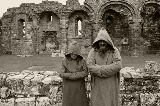 Two monastic figures on Lindisfarne
